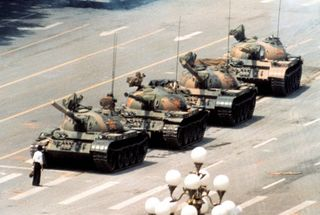 Idener-famously-captured-tank-man-an-anonymous-protester-in-beijings-tiananmen-square-the-picture-symbolized-the-end-of-the-cold-war-era-and-civilians-courage