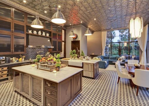 The-kitchen-has-a-unique-tin-ceiling-two-islands-and-a-breakfast-nook
