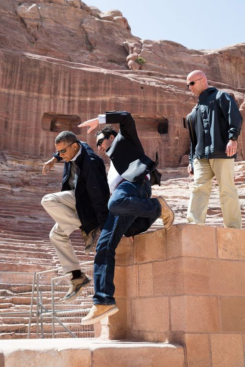 -farajat-a-university-of-jordan-tourism-professor-jump-from-a-ledge-of-the-nabataean-amphitheater-during-a-walking-tour-of-the-ancient-city-of-petra-in-jordan