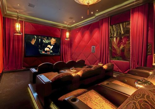 Theres-even-an-opulent-movie-theater-in-the-home-with-red-walls-and-curtains