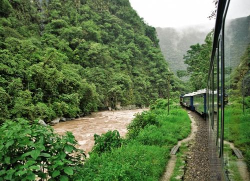 The-train-route-traverses-the-sacred-valley-of-the-incas-along-the-urubamba-river-passing-ancient-ruins-and-fortresses