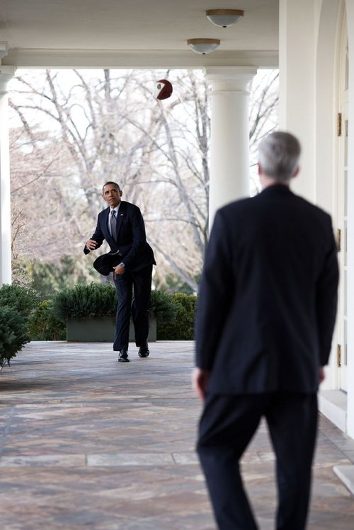 President-barack-obama-throws-a-football-with-chief-of-staff-denis-mcdonough-on-the-colonnade-of-the-white-house