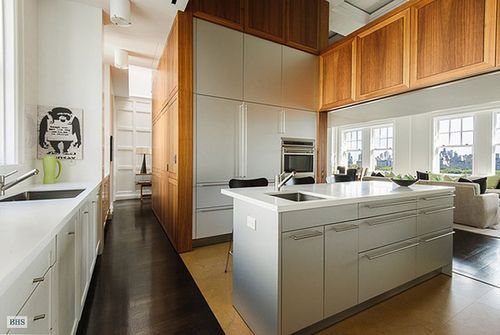 The-eat-in-kitchen-has-top-of-the-line-appliances-custom-cabinetry-and-a-central-island