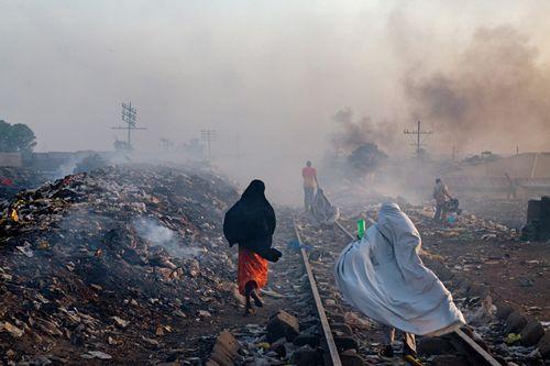 03-scavenging-among-trash-kaduna-670