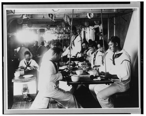 -navy-leading-the-way-this-1899-photo-shows-sailors-eating-on-the-uss-olympia-which-was-americas-flagship-during-the-spanish-american-war-of-the-previous-year