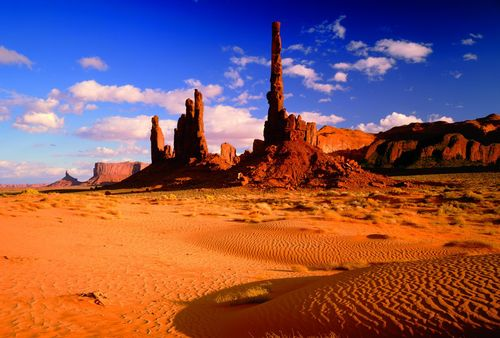 T-valley-tribal-park-on-the-arizona-utah-border-the-sandstone-spires-are-the-result-of-millions-of-years-of-erosion-iron-oxide-gives-the-rock-its-reddish-tone