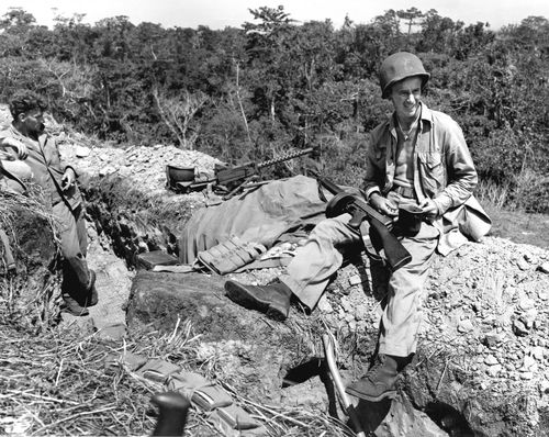 Estern-pacific-prompting-deployment-of-marines-to-the-tropical-island-of-guadalcanal-this-1943-photo-shows-two-armed-marines-waiting-for-chow-call-or-mealtime
