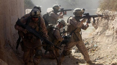 Loyed-to-the-helmand-province-in-southern-afghanistan-following-the-heavy-marine-led-assault-on-marjah-here-is-a-photo-of-them-under-enemy-sniper-fire-in-2010
