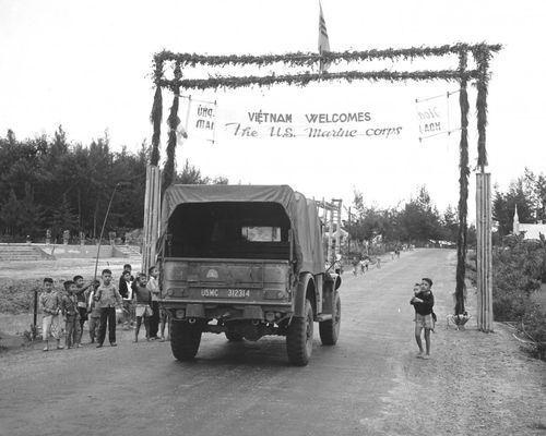 Long-the-vietnam-war-was-the-next-major-us-conflict-this-marine-truck-passes-under-a-welcome-banner-at-the-entrance-of-the-vietnamese-city-danang-back-in-1965