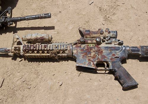 A-blood-covered-M4-rifle--008