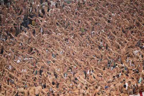 Legia-warszawa-fans-cheer-at-a-europa-league-match-in-rome