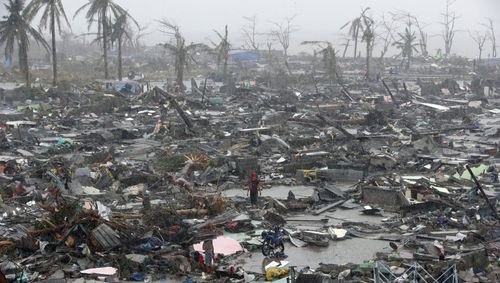 Survivors-stand-among-debris-and-ruins-in-the-philippines-super-typhoon-haiyan-devastated-the-island-nation