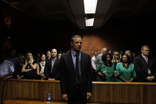South-african-athlete-oscar-pistorius-awaits-the-start-of-court-proceedings-after-being-charged-with-shooting-his-girlfriend